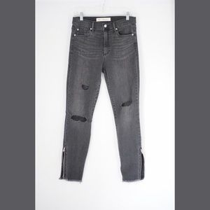 Distressed gray skinny jeans with zip- able cuffs